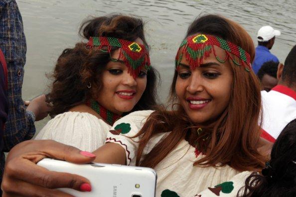 "Oromo women wearing traditional clothes take a selfie during the ""Irreecha"" festival (Oromo Thanksgiving) in Addis Ababa, Ethiopia on 30 September, 2018. [Minasse Wondimu Hailu/Anadolu Agency]"