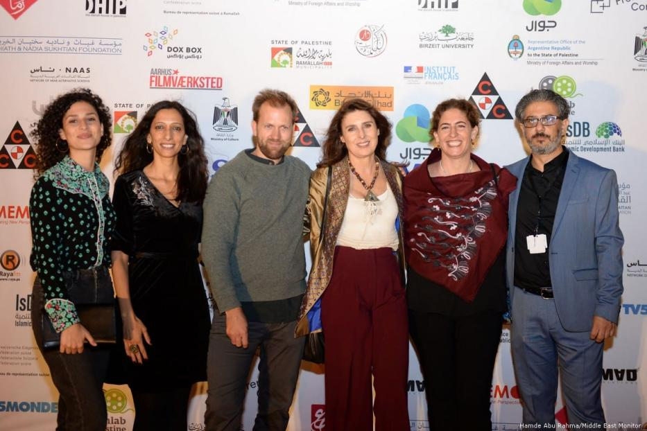 Participants at the launch of the annual Palestine Cinema Days festival at the Cultural Palace in the occupied West Bank city of Ramallah [Hamde Abu Rahma/Middle East Monitor]