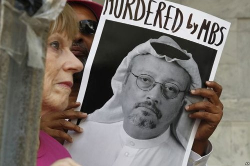 People hold signs during a protest at the Embassy of Saudi Arabia in Washington about the murder of Saudi journalist Jamal Khashoggi [Twitter]