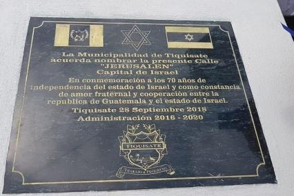 A plaque displaying a street in Guatemala called 'Jerusalem the capital of Israel'