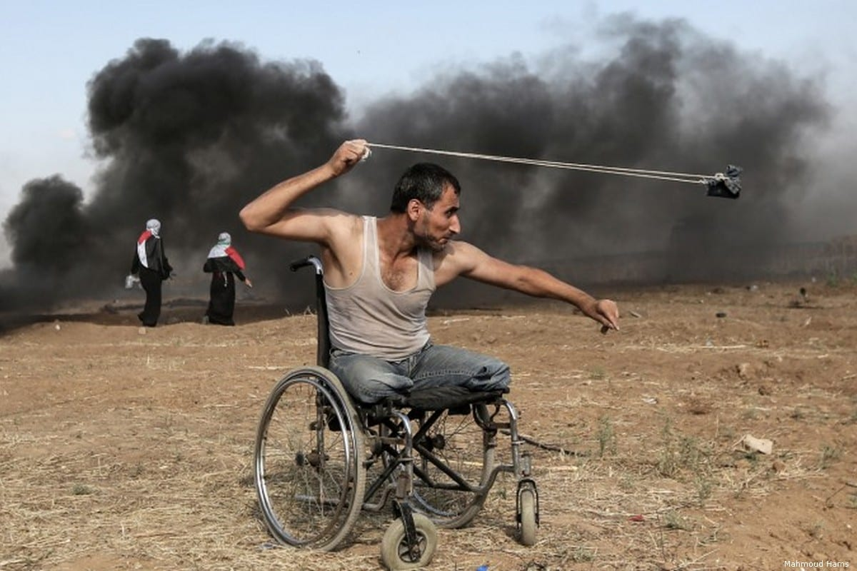 A photo of a Palestinian protester taking part in the Great March of Return in Gaza won a top prize in France's prestigious Bayeux Calvados-Normandy Award for War Correspondents [Mahmoud Hams]