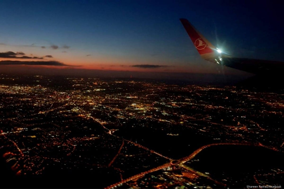 Skyline of Egypt taken from the window plane before landing. 19-year-old Muhammed AbdelKasem took a similar photo which has him arrested by Egyptian forces [Shareen Nawaz/Facebook]