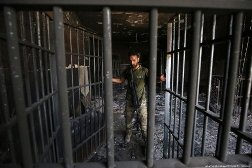 An Iraqi officer inspects a secret prison in Iraq on 30 June 2016 [Ahamd Al-Rubaye/AFP/Getty Images]