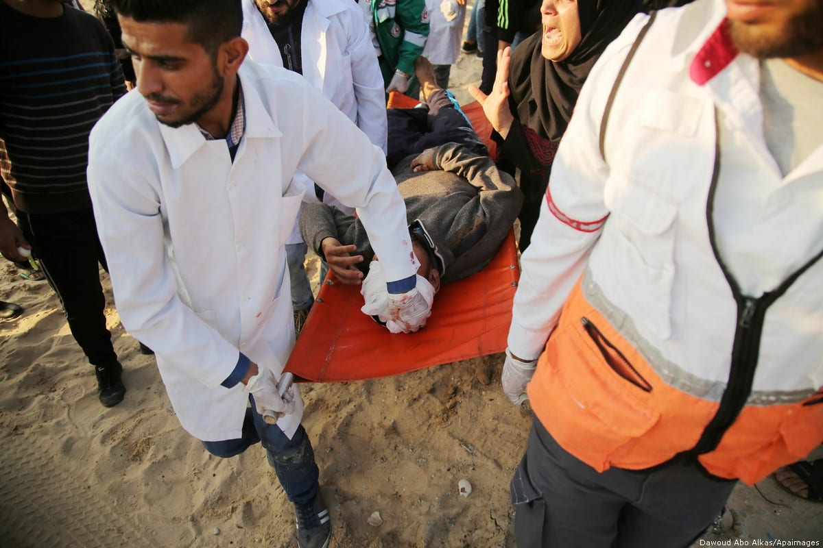 A wounded Palestinian protester is evacuated during clashes with Israeli forces, Gaza Strip 19 November, 2018 [Dawoud Abo Alkas/Apaimages]