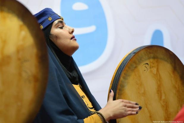 This woman plays traditional music on the drums. Iran, 20 November 2018 [Fatemeh Bahrami/Anadolu Agency]