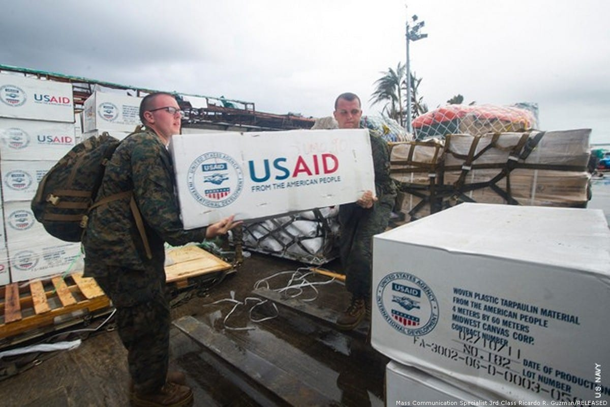 USAID workers move supplies in July 2016 [Mass Communication Specialist 3rd Class Ricardo R. Guzman/USAID Freedom of Information website]