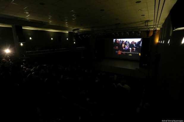 Palestinians watching a film at the 4th Annual Red Carpet Human Rights Film Festival Gaza City, 26 November 2018 [Ashraf Amra/Apaimages]