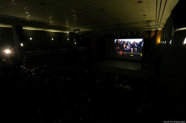 Palestinians watching a film at the 4th Annual Red Carpet Human Rights Film Festival Gaza City, 26 November 2018 [Ashraf Amra/Apaimages]