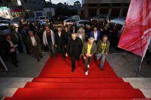 Palestinians were invited to take a walk up the red carpet into the 4th annual human rights film festival in Gaza City, 26 November 2018 [Ashraf Amra/Apaimages]