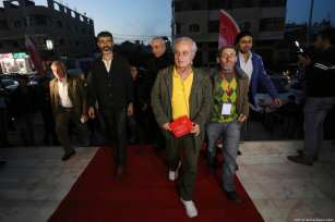 Palestinians walk up the red carpet at the 4th annual film festival, which took place in Gaza City, 26 November 2018 [Ashraf Amra/Apaimages]