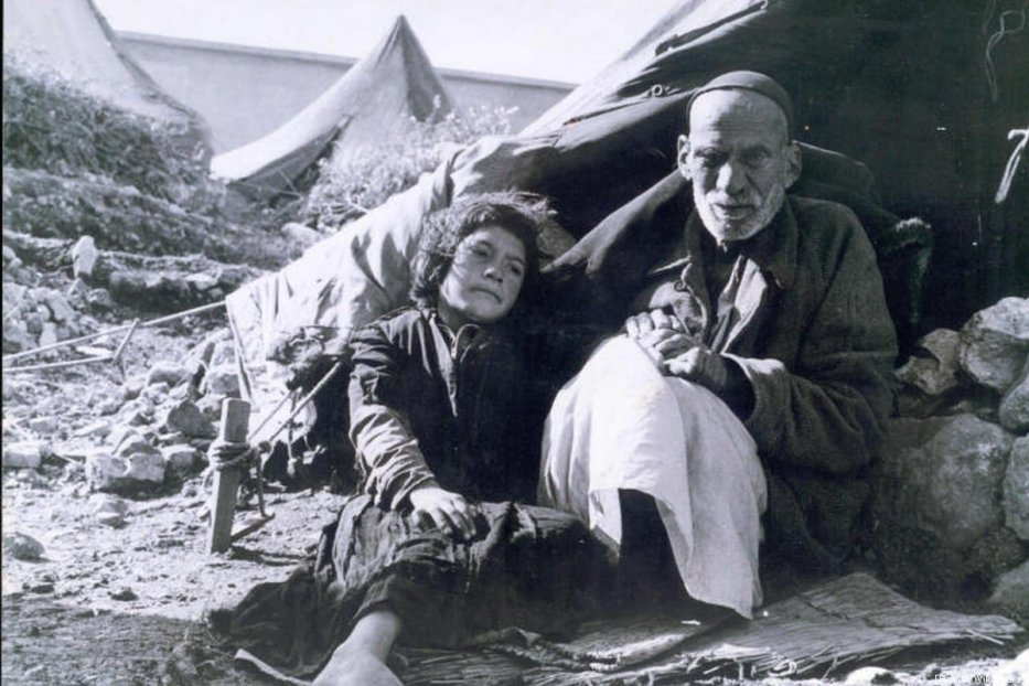 An elderly Palestinian and a child during the Nakba [Hanini/Wikipedia]