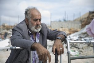 Palestinian Muhammed Al-Rajabi is seen at his building's wreckage after Israeli forces demolished his house with the claim of being unlicensed in Beit Hanina town of Old City, East Jerusalem on 6 November, 2018 [Mostafa Alkharouf/Anadolu Agency]