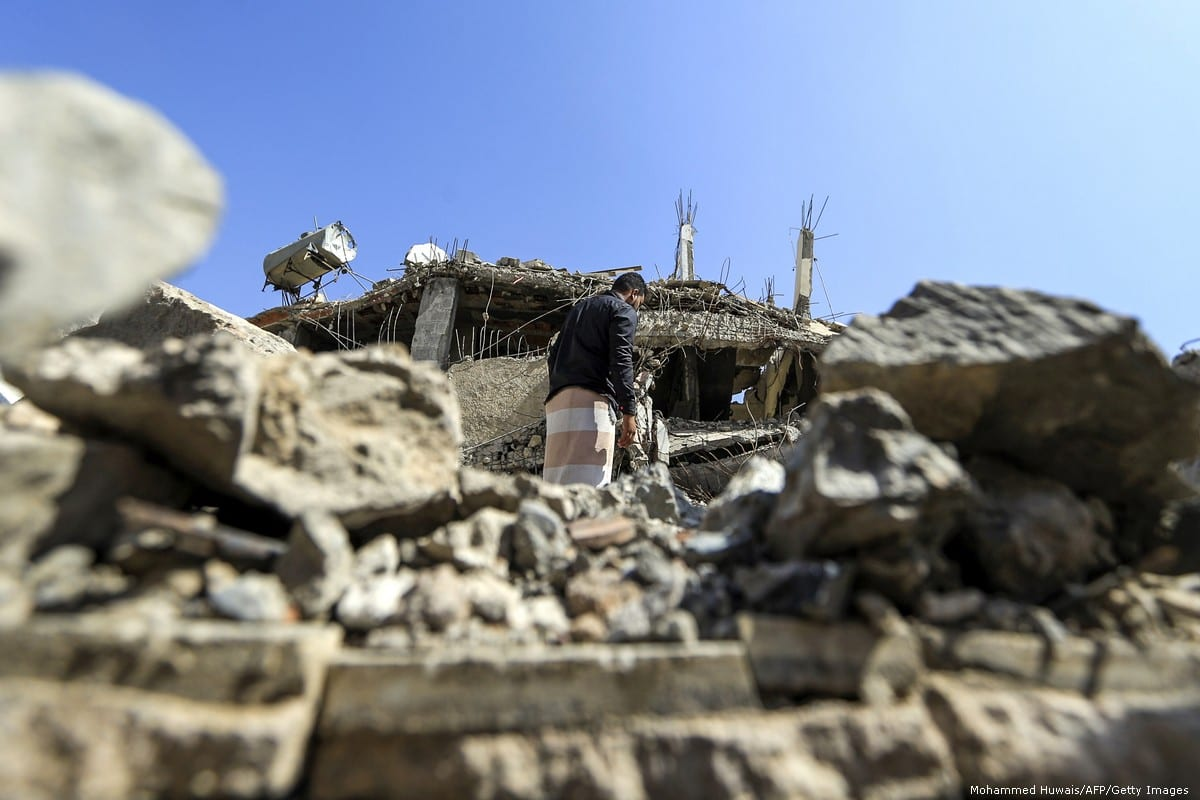 A Yemeni man walks through the rubble of a building destroyed by an air strike carried out by the Saudi coalition in Sanaa, Yemen on 5 September 2018 [Mohammed Huwais/AFP/Getty Images]