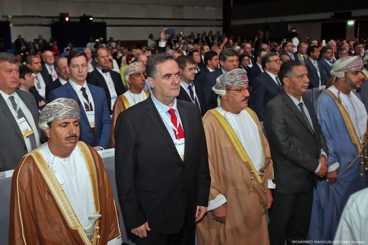 Israeli Minister of Transport Yisrael Katz (2nd-L) stands next to Omani officials during the opening ceremony of the IRU (International Road Transport Union) World Congress in Muscat on 7 November 2018 [MOHAMMED MAHJOUB/AFP/Getty Images]