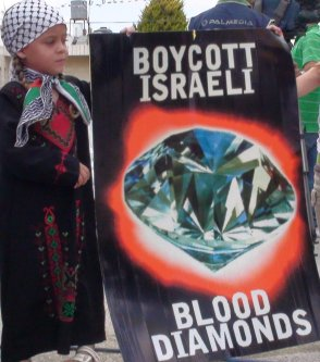 A child holds up a poster calling for the boycott of Israel due to the blood diamond trade