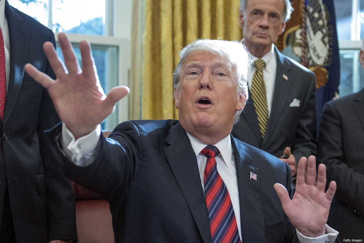 US President Donald Trump speaks to the press pool after signing S.3021, America's Water Infrastructure Act of 2018, in the Oval Office of the White House on October 23, 2018 in Washington, DC [Ron Sachs - Pool/Getty Images]