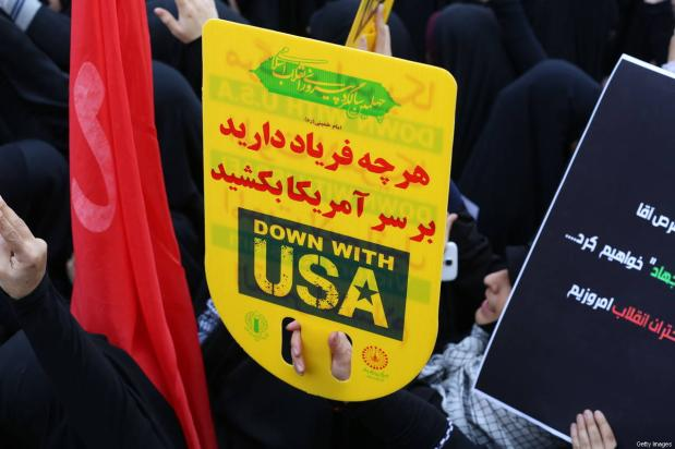 On the eve of renewed sanctions by Washington, Iranian protesters demonstate outside the former US embassy in the Iranian capital Tehran on November 4, 2018, marking the anniversary of its storming by student protesters that triggered a hostage crisis in 1979 [ATTA KENARE/AFP/Getty Images]