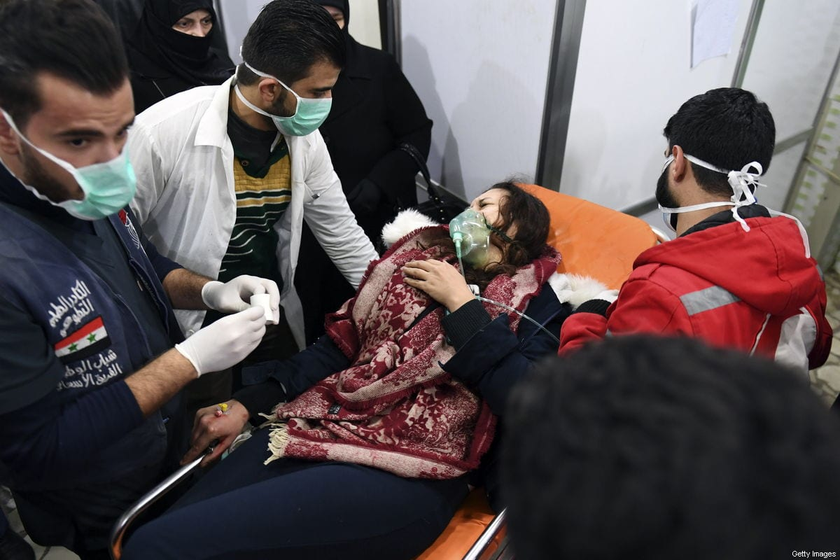 A Syrian woman receives treatment at a hospital after a 'toxic gas&#039 attack in the regime controlled Aleppo