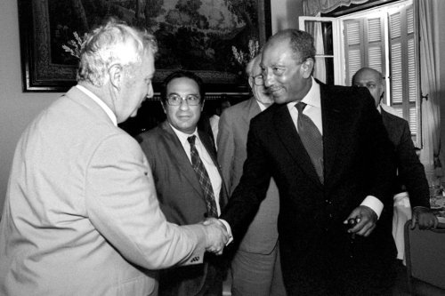 Then-Israeli Defense Minister Ariel Sharon (L) meets with Egyptian President Anwar Sadat August 25, 1981 in Alexandria, Egypt. [Chanania Herman/GPO/Getty Images]