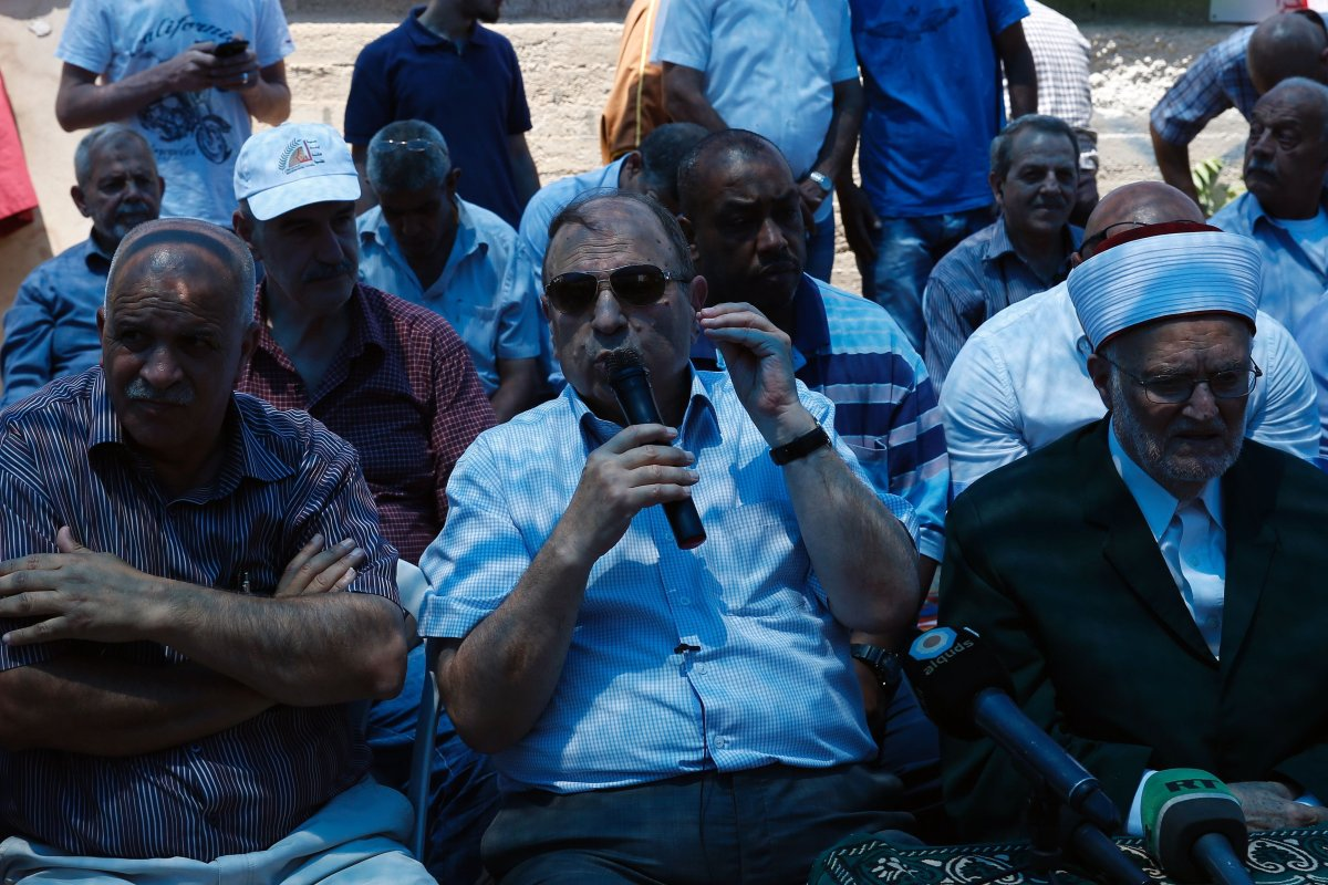 Adnan al-Husayni (C), Minister of Jerusalem Affairs and member of the Executive Committee of the Palestine Liberation Organisation (PLO) in Jerusalem on 11 August 2017 [Ahmad Gharbali/AFP/Getty Images]