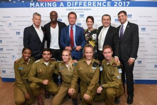 David Foster, Seal, Arnold Schwarzenegger, Cheryl and Haim Saban and Consul General of Israel in Los Angeles Sam Grundwerg with IDF soldiers at the FIDF Western Region Gala held at The Beverly Hilton Hotel on 2 November, 2017 in Beverly Hills, California. [Shahar Azran/Getty Images]