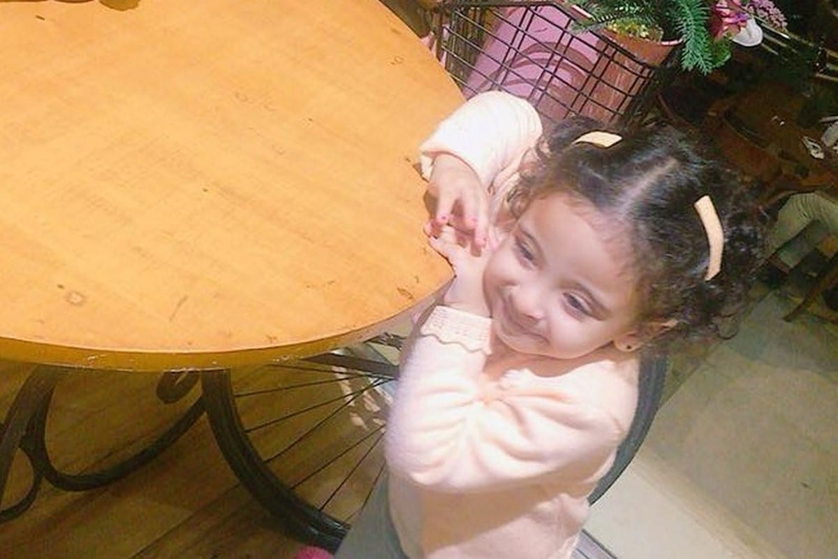 Laila, the two-year-old daughter of political prisoner Ahmed who has been charged with the assassination of Egypt's prosecutor-general Hisham Barakat