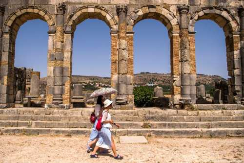 Tourists walk through the ruins of the ancient Roman site in Morocco [FADEL SENNA/AFP/Getty Images]