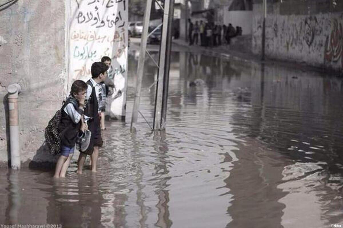 Palestinian school children can be seen in sewage water [Twitter