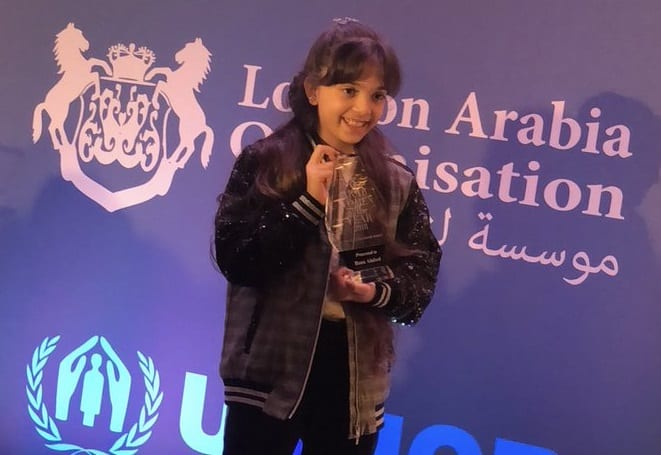 Nine-year-old Syrian Bana Alabed won the coveted Youth Achievement Award at the Arab Women of the Year awards ceremony in London, UK [Bana Alabed/Twitter]
