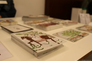 Postcards of some of the tapestries on display for sale on 11 December 2018 [Abdelrahman Said/Middle East Monitor]