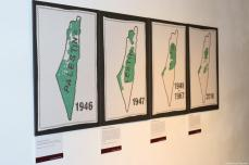 This tapestry depicts the erosion of Palestinian borders since 1946 on 11 December 2018 [Middle East Monitor]