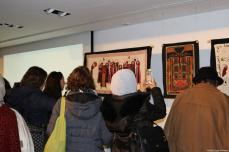 Guests take photos of the Palestinian tapestries at the Palestinian History Tapestry event at P21 gallery in London on 11 December 2018 [Middle East Monitor]