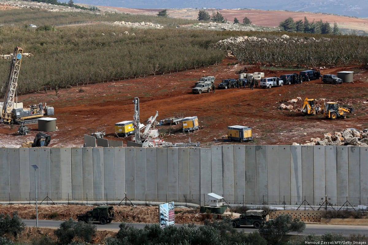 Israeli machinery (top) can be seen on 4 December 2018 operating next to the concrete border wall between Israel and Lebanon after Israel announced it launched an operation to 'destroy Hezbollah tunnels' in the area [Mahmoud Zayyat/AFP/Getty Images]