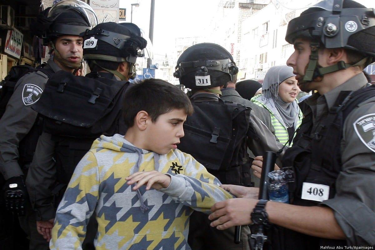 Israeli forces arrest a Palestinian Child on 22 November 2012 in East Jerusalem [Mahfouz Abu Turk/Apaimages]