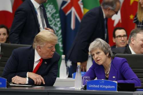 President Donald Trump (L) chats with British Prime Minister Theresa May (R) during a special session entitled 'Fair And Sustainable Future' as part of G20 Leaders' Summit in Buenos Aires, Argentina on 30 November 2018. [ Murat Kaynak - Anadolu Agency ]