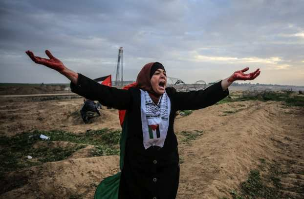 "A Palestinian reacts during a protest within the ""Great March of Return"" demonstrations in Shuja'iyya neighborhood of Gaza City, Gaza on December 07, 2018. ( Ali Jadallah - Anadolu Agency )"