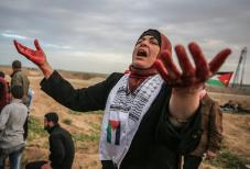 """A Palestinian reacts during a protest within the """"Great March of Return"""" demonstrations in Shuja'iyya neighborhood of Gaza City, Gaza on December 07, 2018. ( Ali Jadallah - Anadolu Agency )"""