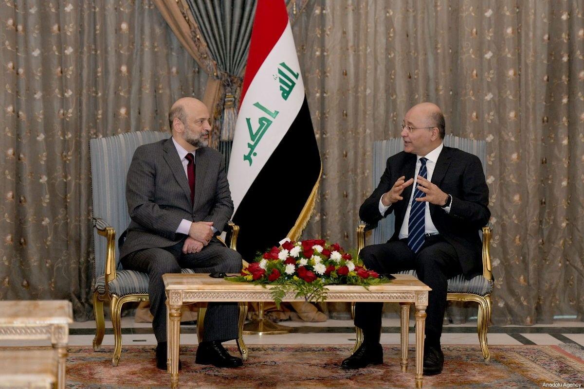 Iraqi President Barham Salih (R) and Jordanian Prime Minister Omar Razzaz (L) are seen during their meeting at presidential palace in Baghdad, Iraq on 29 December 2018 [Iraqi Presidency Press Office/Anadolu Agency]