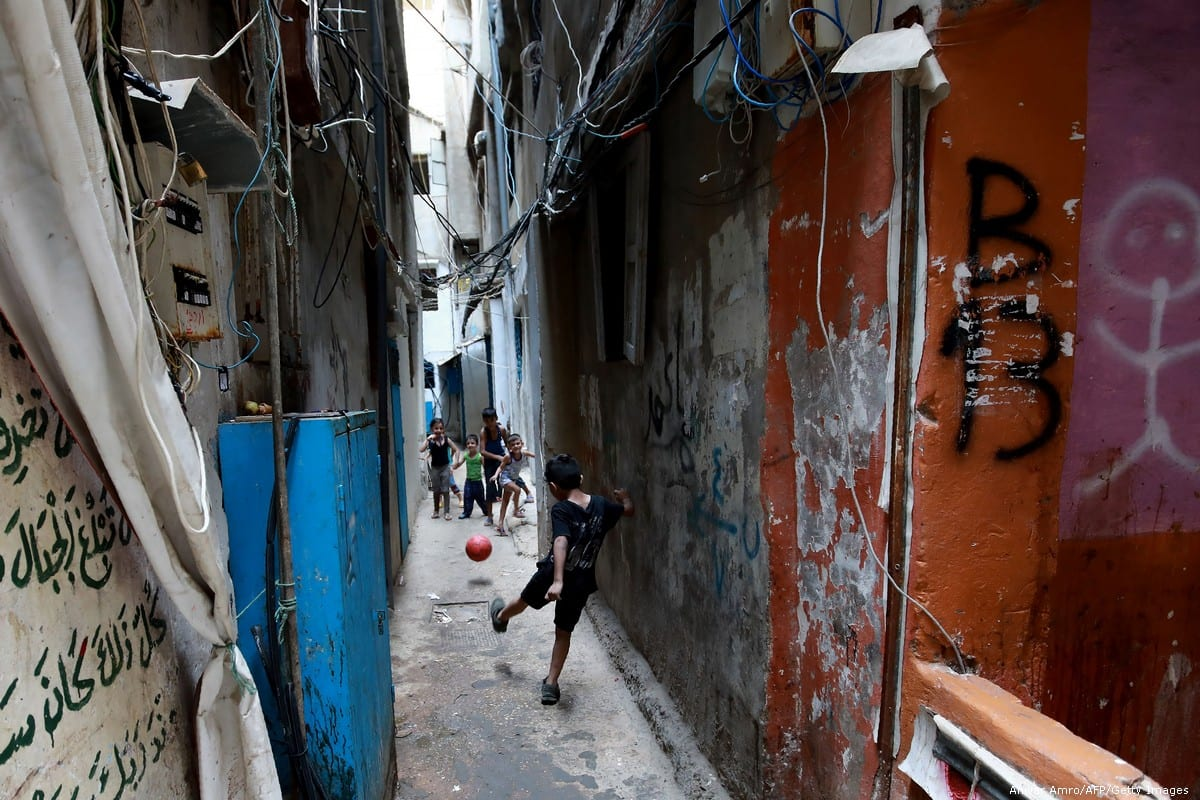Children play at a Palestinian refugee camp in Beirut, Lebanon on 1 September 2018 [Anwar Amro/AFP/Getty Images]