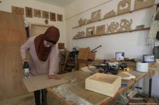 Walaa Abu Aisha a Palestinian carpenter in Gaza can be seen creating her next artwork [Mohammed Asad/Middle East Monitor]