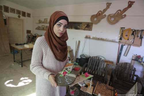 Walaa Abu Aisha, a Palestinian carpenter in Gaza [Mohammed Asad/Middle East Monitor]