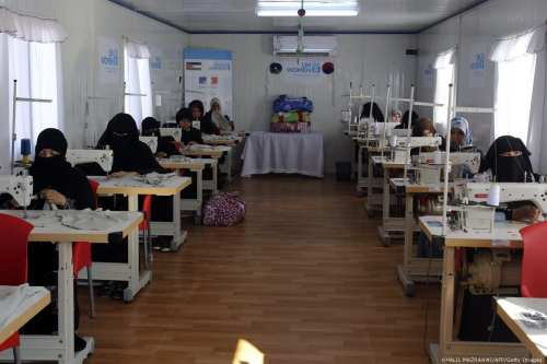 Syrian refugees attend a sewing class in Jordan on 2 August, 2018 [ KHALIL MAZRAAWI/AFP/Getty Images]