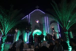 Christians in Gaza take part in Christmas mass on 24 December 2018 [Mohammed Asad/Middle East Monitor]