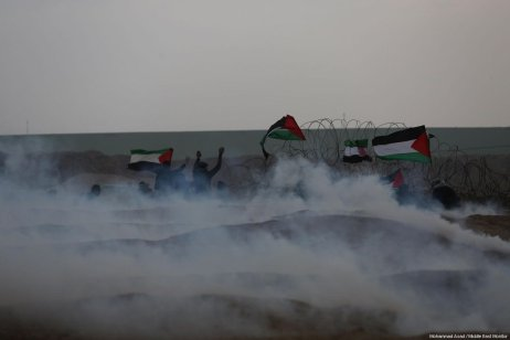 "Palestinians seen at the Gaza-Israel border during a protest within the ""Great March of Return"" demonstrations in Shuja'iyya neighborhood of Gaza City, Gaza on December 07, 2018 [Mohammad Asad / Middle East Monitor]"