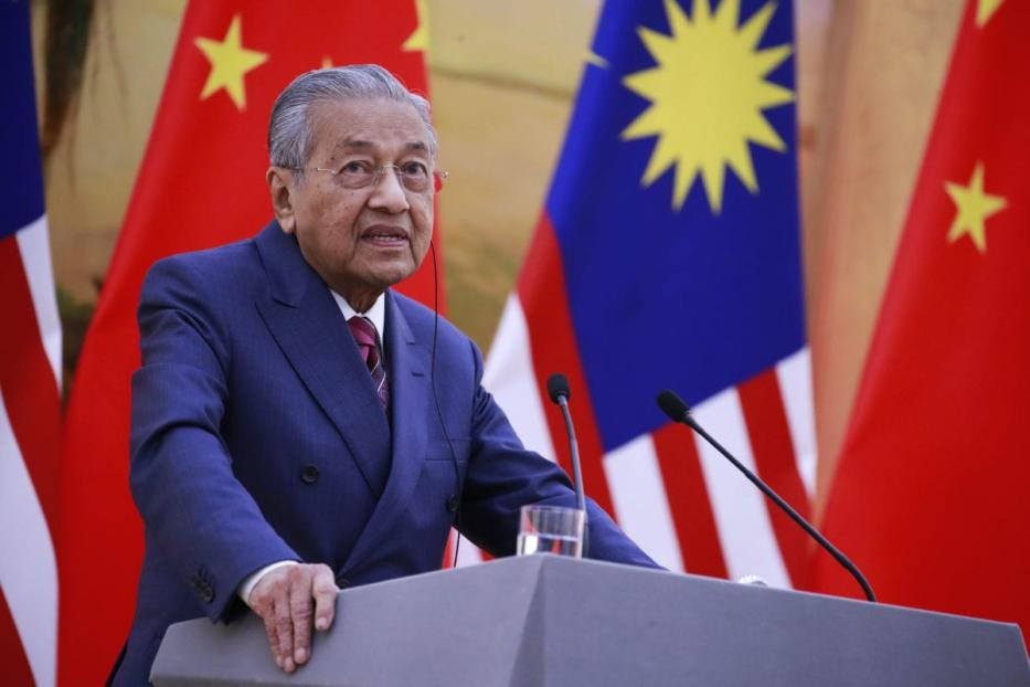 Malaysian Prime Minister Mahathir Mohamad speaks to reporters during a press conference at the Great Hall of the People (GHOP) in Beijing, China, 20 August 2018 [How Hwee Young - Pool/Getty Images]