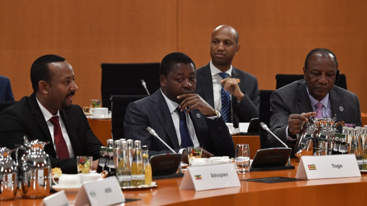 "(LtoR) Ethiopia's Prime Minister Abiy Ahmed Ali, Togo's President Faure Gnassingbe and Guinea's President Alpha Conde take part in a meeting at the ""Compact with Africa"" conference on trade, aid and diplomacy on October 30, 2018 at the Chancellery in Berlin. (Photo by JOHN MACDOUGALL/AFP/Getty Images)"