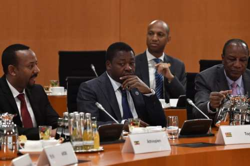 """(LtoR) Ethiopia's Prime Minister Abiy Ahmed Ali, Togo's President Faure Gnassingbe and Guinea's President Alpha Conde take part in a meeting at the """"Compact with Africa"""" conference on trade, aid and diplomacy on October 30, 2018 at the Chancellery in Berlin. (Photo by JOHN MACDOUGALL/AFP/Getty Images)"""