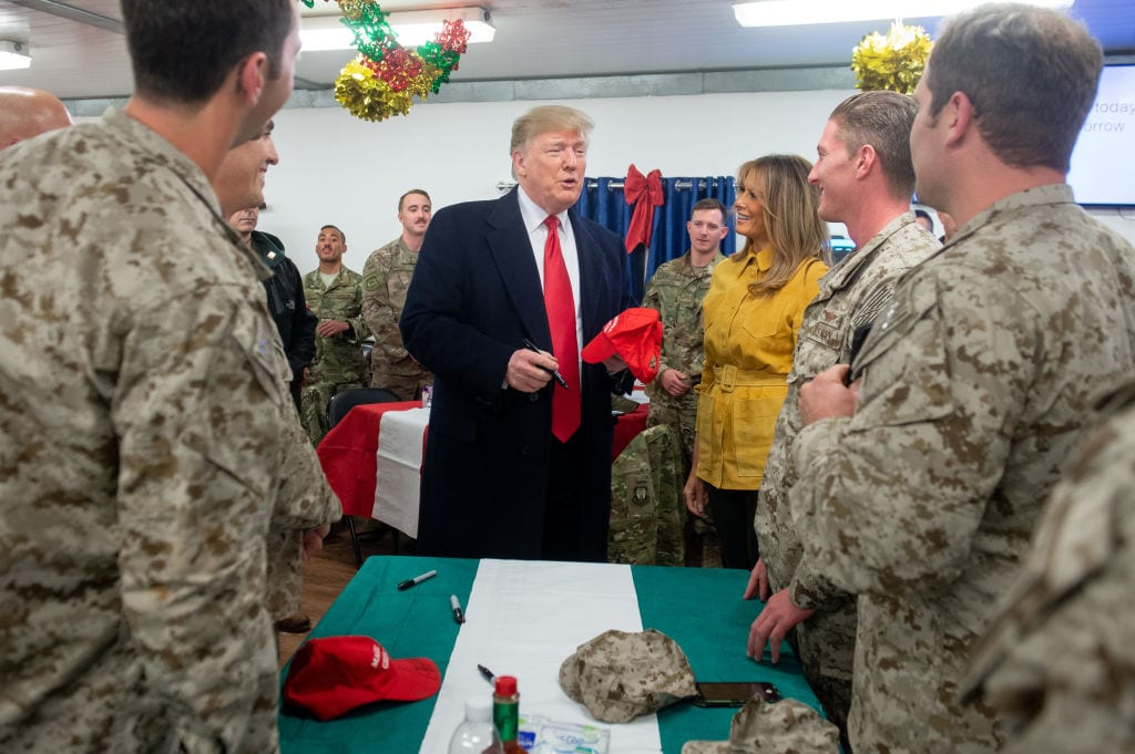 US President Donald Trump and First Lady Melania Trump greet members of the US military during an unannounced trip to Al Asad Air Base in Iraq on December 26, 2018. (Photo by SAUL LOEB/AFP/Getty Images)