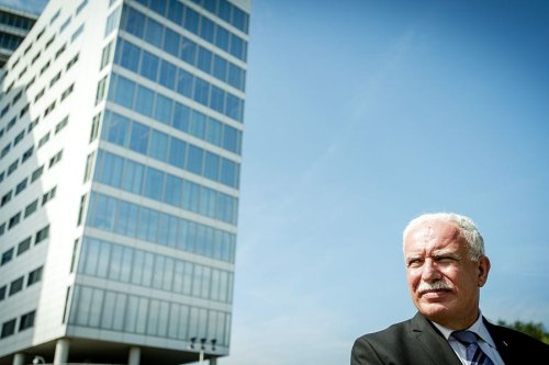 The Foreign Minister of the Palestinian Authority, Riyad al-Maliki, leaves the International Criminal Court (ICC) in The Hague, on 25 June, 2015 [ROBIN VAN LONKHUIJSEN/AFP/Getty Images]