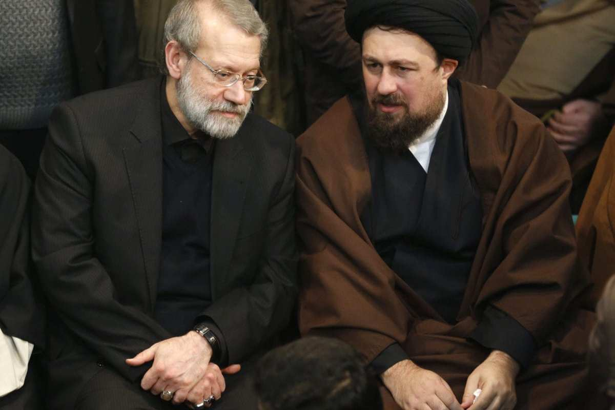 Iranian Parliament speaker Ali Larijani (L) speaks with Hassan Khomeini, grandson of Iran's late founder of the Islamic Republic, during a mourning ceremony for the former Iranian president Akbar Hashemi Rafsanjani at the Jamaran mosque in Tehran on January 9, 2017. (Photo by ATTA KENARE/AFP/Getty Images)